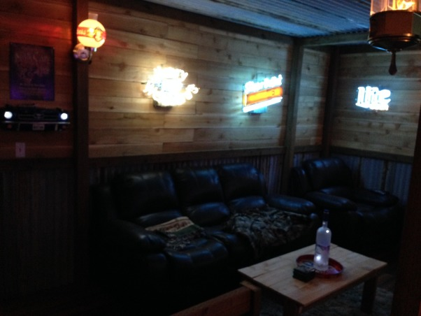 Rustic Barn/Bar Man Cave, Rustic Barn/Bar Feel!!! I needed a spot In my new place that would capture the memories I have as a little boy of my aunts house/barn. These memories were the best! I wrapped all the walls in corrugated metal and cedar fencing. Followed up with pressure treated 4x4's and 2x4's for trim, post, and beams. I also built  the bar and fireplace from scratch out of the same materials for which emulates a bar/fireplace in Deadwood SD. Hope you enjoy it as much as I do!! :-), Media Rooms Design