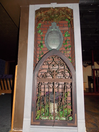 Haunted Mansion theater/ Pirate bar, I have turned an unfinished basement into a Disney Haunted Mansion theater and a Pirates of the Caribbean Bar.  Still more work to be done...but it's coming along., Updated Haunted Mansion Plaque display.  Gate and plants added., Media Rooms Design