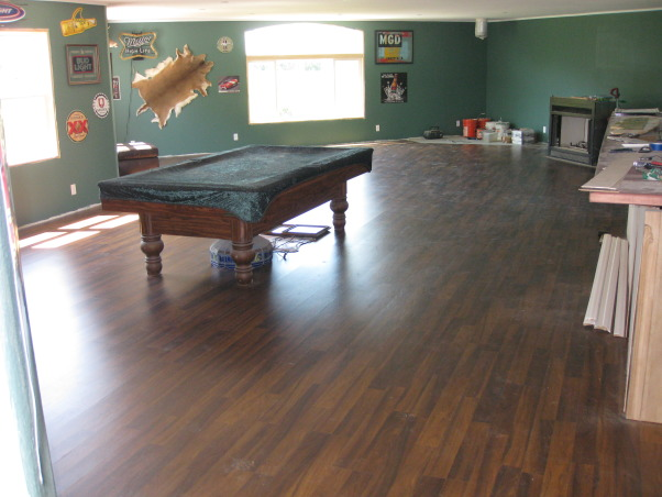 Garage/Game Room Bar, 1800 square foot per floor with a 1400 square foot game room bar upstairs. I built the garage from the foundation up including building the cabinets for my 17 foot long bar. I also restored my 1930 pool table., Garages Design
