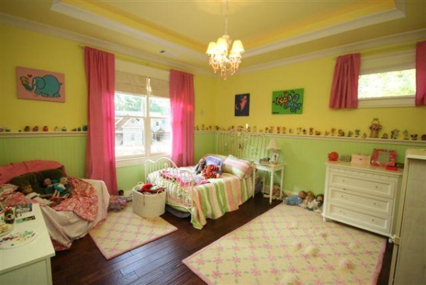 very sunny fairy room, Ok - so I know the colors are a bit much - but we let our daughter pick them.  Did our best to coordinate!  Nice big space, beadboard wall with ledge for her fairy collection, sweet chandelier, trey ceiling with rope light on dimmer used as a night night.  Bathroom has pink tile accents, a great pink Kohler sink, vanity area and lots of storage.  If only I could get her to keep it clean!, girlie girl room with lots of fairies!, Girls' Rooms Design