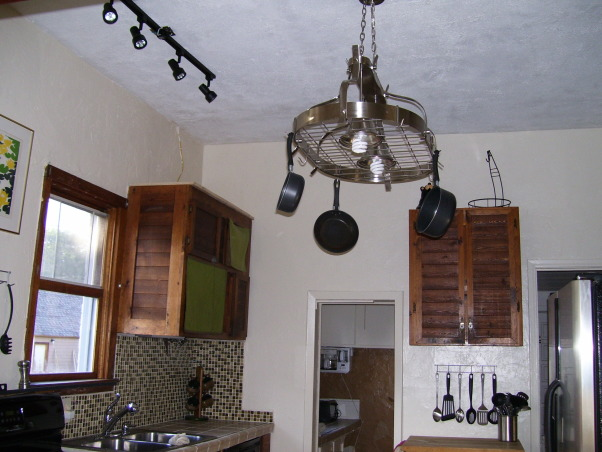 drop ceilings be gone remodel, we remodeled our kitchen on a very limited budget.  We raised up the torn up drop ceilings.  We tore out the plaster ceilings ourtselves (talk about messy).  We installed new tile countertops (never did tiling before), and we knocked out part of a wall/window to open up the kitchen to the dining area.  , I decided to put a pot rack light fixture up, along with track lighting, because I couldn't imagine using plain lights or a ceiling fan.   , Kitchens Design