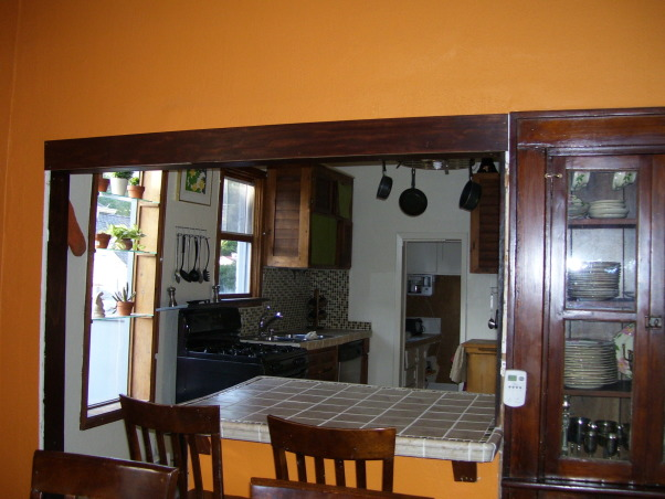 drop ceilings be gone remodel, we remodeled our kitchen on a very limited budget.  We raised up the torn up drop ceilings.  We tore out the plaster ceilings ourtselves (talk about messy).  We installed new tile countertops (never did tiling before), and we knocked out part of a wall/window to open up the kitchen to the dining area.  , We're still working on the trim.  Definitely not our specialty., Kitchens Design