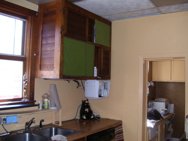 drop ceilings be gone remodel, we remodeled our kitchen on a very limited budget.  We raised up the torn up drop ceilings.  We tore out the plaster ceilings ourtselves (talk about messy).  We installed new tile countertops (never did tiling before), and we knocked out part of a wall/window to open up the kitchen to the dining area.  , laminate counters that have to be at least 50 years old.  Nothing against laminate, but they were horrible, and made the kitchen look small , Kitchens Design