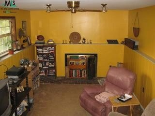 "Not exactly a basement. The house is a trilevel and this is the downstairs den, Not exactly a basement. The house is a trilevel and this is the downstairs den. It needs sooo much work please help  lol, This is the downstairs den. The BAD: yellow!! the border around the room and the covered up fireplace The Good: potential?  lol  the furniture will be goneThis are the pics we have taken. We are closing on the house in a few days so these are kind of out ""before"" pics, Basements Design"