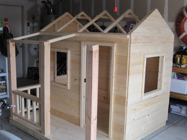 The Moveable Playhouse!, We are currently renting a house with a small backyard... I wanted to build a playhouse for my boys that could be completely taken apart and moved.  I also wanted something that would 'attract' rather than 'detract' from our exterior space.  I built it in the garage for two reasons... I knew it was going to be tricky working in the hot New Mexico sun and was worried about wood warping and second, it ensured that I would be able to take it apart.  Amazingly, I only had to cut off one misplaced screw in order to drop the walls and move it out!  The whole project took about two weeks working on a part time basis... now I've got a list of parents that would like me to help them build one for their kids in their backyards!, Added the porch and put up the trusses...     , Other Spaces Design