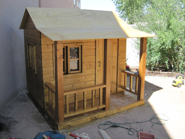 The Moveable Playhouse!, We are currently renting a house with a small backyard... I wanted to build a playhouse for my boys that could be completely taken apart and moved.  I also wanted something that would 'attract' rather than 'detract' from our exterior space.  I built it in the garage for two reasons... I knew it was going to be tricky working in the hot New Mexico sun and was worried about wood warping and second, it ensured that I would be able to take it apart.  Amazingly, I only had to cut off one misplaced screw in order to drop the walls and move it out!  The whole project took about two weeks working on a part time basis... now I've got a list of parents that would like me to help them build one for their kids in their backyards!, The move was a success and reconstruction is complete!   , Other Spaces Design