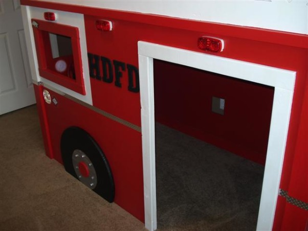 Fire Truck Room, I built a Fire Truck bed for my son, he is crazy about Fire Trucks!  I modified a plan off of www.ana-white.com and am thrilled with how the bed turned out.  More pictures and step by step building on www.atouchofarkansas.com, Door to play area  , Boys' Rooms Design