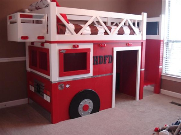 Fire Truck Room, I built a Fire Truck bed for my son, he is crazy about Fire Trucks!  I modified a plan off of www.ana-white.com and am thrilled with how the bed turned out.  More pictures and step by step building on www.atouchofarkansas.com, The lights have a toggle switch to turn on, adding 2 beacon lights soon.  , Boys' Rooms Design