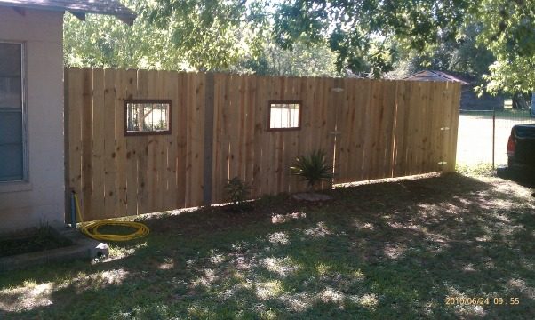 Fence With Windows, Fence with windows and working shutters to allow more or less wind flow.  I had planned to post the before pic but it is gone. We did build the fence to as it did not have one., This is the right front of the property with a 10' gate.      , Yards     Design