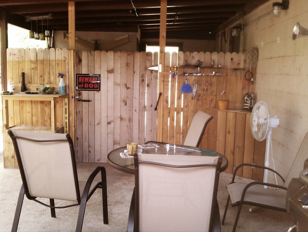 Carport to Patio, We wanted a place to smoke outside with privacy, avoid the dogs and hide the outside laundry room that was out on the carport.  So we fenced it up and made our little outside room and let the dogs and laundry have a part of it too., This is our smokers corner where we can watch the rain, b-b-q, watch the squirrels and birds and it is also my outside work area. Behind the sign is the laundry and dog area. , Other Spaces Design