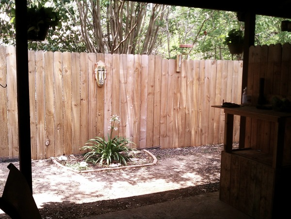 Carport to Patio, We wanted a place to smoke outside with privacy, avoid the dogs and hide the outside laundry room that was out on the carport.  So we fenced it up and made our little outside room and let the dogs and laundry have a part of it too., The garden in progress. , Other Spaces Design