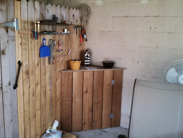 Carport to Patio, We wanted a place to smoke outside with privacy, avoid the dogs and hide the outside laundry room that was out on the carport.  So we fenced it up and made our little outside room and let the dogs and laundry have a part of it too., Corner cabinets, this one actually hides our dryer vent. Made from excess fence wood. We used the fence and wall for the backsides of the cabinet., Other Spaces Design