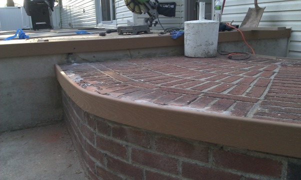 My own epoxy pebble beach, Beach Pebble epoxy patio, edges of bricks repaired with concrete and trex anchored in with PL also, relief cuts made on inside edge to make bending easier     , Patios & Decks Design