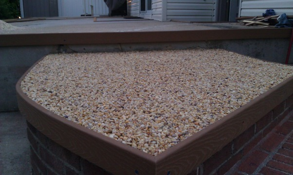 My own epoxy pebble beach, Beach Pebble epoxy patio, trex edges act as a ledger board to run a straight edge across and maintain level surface.      , Patios & Decks Design