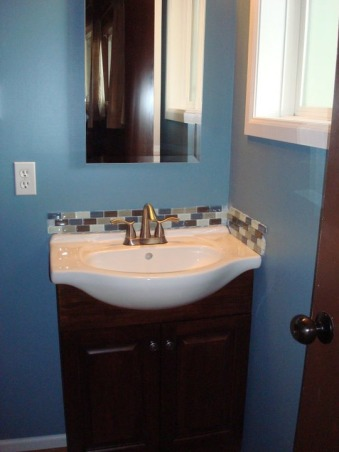 1/2 bath remodel, This 4X6 bath i believe was original to it's building in 1969.... and it looked it!, Sink base and tile installed, Bathrooms Design