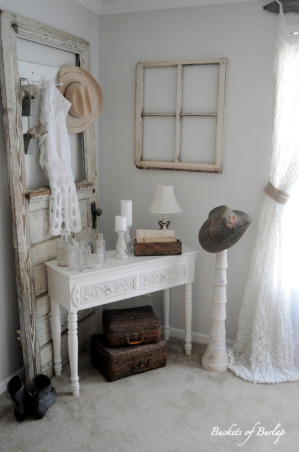 Rustic Romantic Master Bedroom, With soft gray walls and a DIY recycled headboard, this master bedroom has a rustic, yet romantic feel., Cozy corner in master bedroom with vintage door, bottles, and old hats   , Bedrooms Design