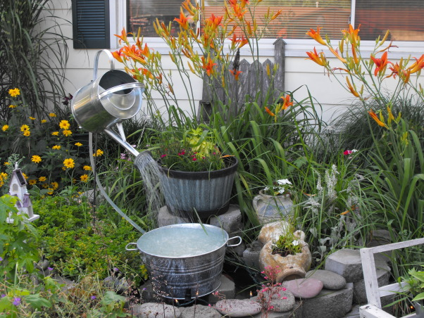 front yard, front yard landscaping, watering can fountain, Yards Design