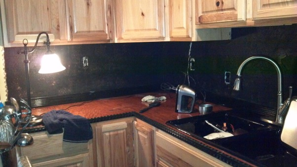 Copper Penny Back Splash, I used unsanded black grout, because of the black trim through out kitchen and living room.  Also bought it at Lowe's.    , Kitchens Design