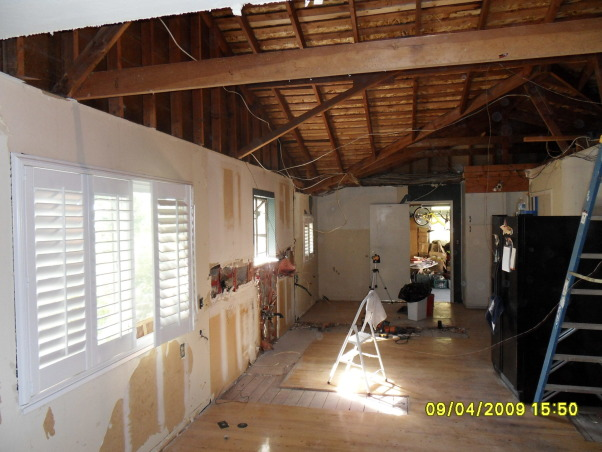 "Complete Remodeled Kitchen, We took down two walls and raised the ceiling 24"". Original kitchen was only 14' x 12'. It is now, approximately 30' x 12'. We combined an old laundry room, dinning nook and kitchen to create a beautiful new kitchen with tons of space., After all demolition has been completed and the new space is ready for its new kitchen., Kitchens Design"