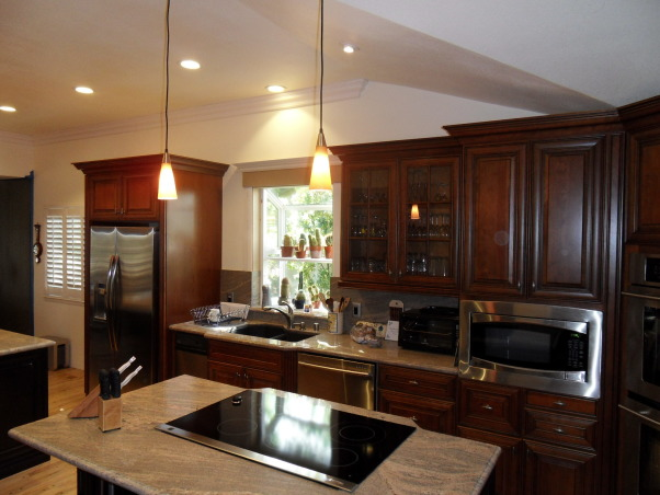 "Complete Remodeled Kitchen, We took down two walls and raised the ceiling 24"". Original kitchen was only 14' x 12'. It is now, approximately 30' x 12'. We combined an old laundry room, dinning nook and kitchen to create a beautiful new kitchen with tons of space., Beautiful custom cherry cabinets, LED recessed lighting and custom granite counter-tops., Kitchens Design"