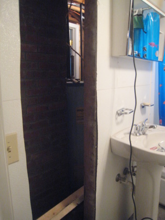 Rental Bathroom Makeover, Started with a small, cheap, dingy bathroom basement. Added storage & nicer hardware. Made it feel bigger with a pedestal sink, large mirror, & glass shower doors., Step 4: Cut hole in wall for recessed storage , Bathrooms Design