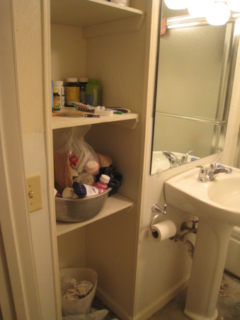 Rental Bathroom Makeover, Started with a small, cheap, dingy bathroom basement. Added storage & nicer hardware. Made it feel bigger with a pedestal sink, large mirror, & glass shower doors., Step 8: Installed shelving , Bathrooms Design
