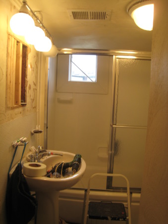 Rental Bathroom Makeover, Started with a small, cheap, dingy bathroom basement. Added storage & nicer hardware. Made it feel bigger with a pedestal sink, large mirror, & glass shower doors., Step 6: New lighting & nasty medicine cabinet gone! , Bathrooms Design