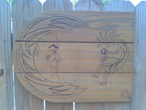 Fence With Windows, Fence with windows and working shutters to allow more or less wind flow.  I had planned to post the before pic but it is gone. We did build the fence to as it did not have one., This is on the large gate. I drew this and used a wood burner. Of course you can't have a sun without a moon.  , Yards     Design