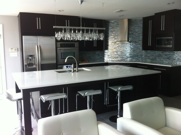 sleek, classy, contemporary kitchen, espresso slab cabinets, white quartz counters, delta touch faucet, crystal island light, glass backsplash, Kitchens Design