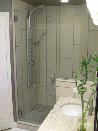 Master Bath Remodel, We had to update our master bath due to a shower leak.  This is what we came up with., Shower system and frameless glass shower.  Second to none!, Bathrooms Design