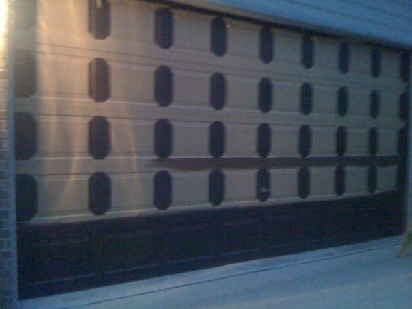 Amazing Faux Wood Garage Door, Painted aluminum garage doors to look like walnut wood. , Garages Design