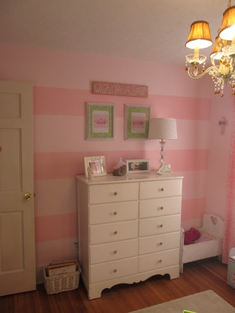 Emalea's Room, This is our little princesses room.  We have three, this is our youngest room.  Of course with a Princess theme.  I painted all the walls with two different pink colors.  I drew the castle and my sister in law did all the vinyl for the walls.  She has her own vinyl business.  I have a love for eclectic decor.  The majority of my things are garage sale finds that I have painted or refurbished.   , Bedrooms Design