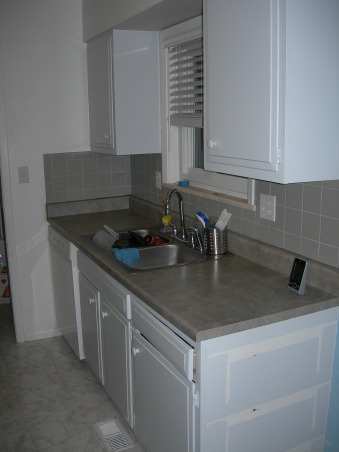 Gator's kitchen remodel, small galley kitchen with attached laundry area., cabinets were the original ones. The drawers were plastic. Not enough storage. , Kitchens Design