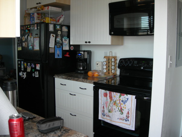 Gator's kitchen remodel, small galley kitchen with attached laundry area., New kichen with new appliances. Added a storage cabinet above refridgerator. They go all the way to the ceiling. All are soft closing. , Kitchens Design