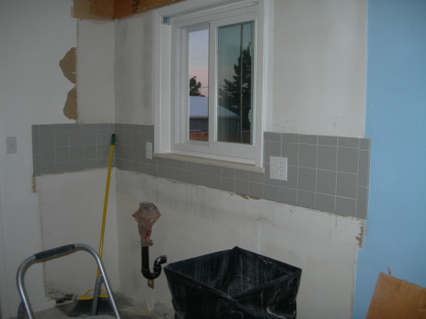 Gator's kitchen remodel, small galley kitchen with attached laundry area., Demo has started. Took out all cabinets. Both soffets and all the tile. , Kitchens Design