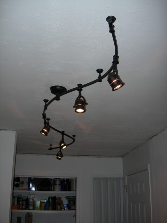 Gator's kitchen remodel, small galley kitchen with attached laundry area., Took down the popcorn ceiling. Textured and put this really cool lighting. Each light is adjustable. Very easy to install. , Kitchens Design