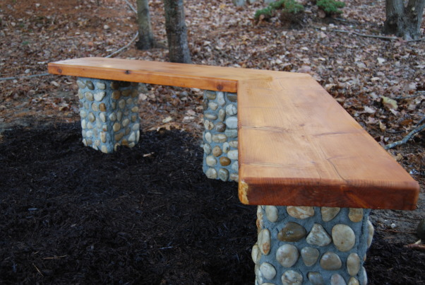 350 Year Old, Brand New Bench, Seat is from a 102 inch long board salvaged from a 350 year old building.  Columns are veneered with Mexican beach stones.  16 inch square concrete blocks act as foundations.  Four foot rebar through the pads anchor the pads and the columns.  (2) 8 inch galvanized lag screws anchor the seat into the mortar filled columns.  , Replacement for a rotted bench.  16 x 16 pads with four foot rebars through the pads and into the hollow single concrete blocks.  8 inch galvenized lag screws (2 per column) screwed and glued into the board and imbedded into the mortar filling the concrete blocks.        , Gardens Design