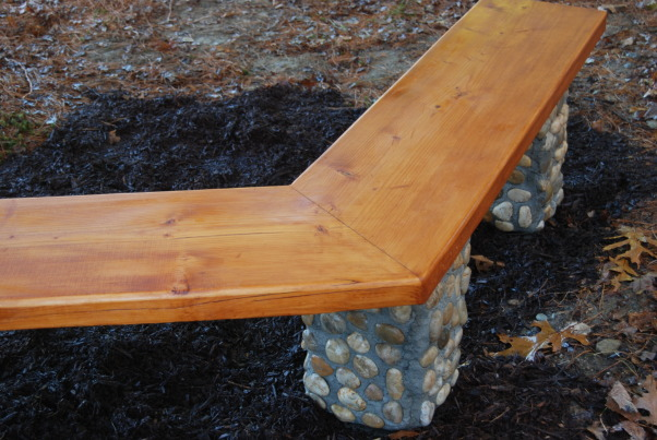 350 Year Old, Brand New Bench, Seat is from a 102 inch long board salvaged from a 350 year old building.  Columns are veneered with Mexican beach stones.  16 inch square concrete blocks act as foundations.  Four foot rebar through the pads anchor the pads and the columns.  (2) 8 inch galvanized lag screws anchor the seat into the mortar filled columns.  , Mexican Beach Stone veneered columns.  350 year old board, 102 inches long, given new life.  Sealed and stained.      , Gardens Design