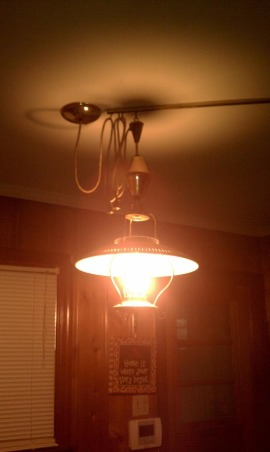 1950s trash or treasure, My kitchen has knotty pine walls with original built in wood cabinets.  I have appliances that were hand me downs but happy to have something instead of nothing., 1950s light that looks like a lantern, Kitchens Design