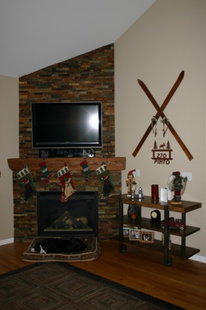 Fireplace Update, We needed a new space to fit in with the room and accommodate the flat TV.  We took old tile down, framed out the old Media hole, and found a nice reclaimed piece of wood to compliment the stacked stone tile., Even the puppy likes it as she waits for Santa , Other Spaces Design