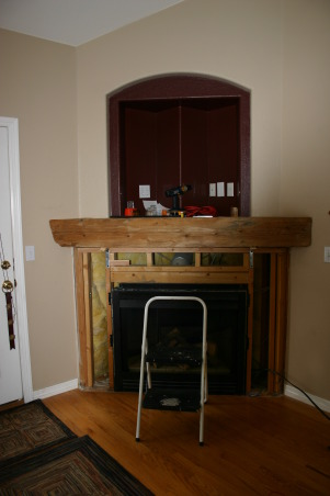 Fireplace Update, We needed a new space to fit in with the room and accommodate the flat TV.  We took old tile down, framed out the old Media hole, and found a nice reclaimed piece of wood to compliment the stacked stone tile., added a piece of reclaimed lumber for the mantel   , Other Spaces Design