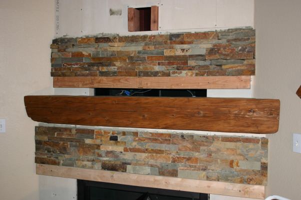 Fireplace Update, We needed a new space to fit in with the room and accommodate the flat TV.  We took old tile down, framed out the old Media hole, and found a nice reclaimed piece of wood to compliment the stacked stone tile., started to stack the tiles   , Other Spaces Design