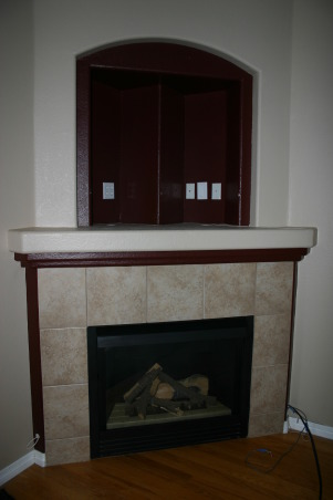 Fireplace Update, We needed a new space to fit in with the room and accommodate the flat TV.  We took old tile down, framed out the old Media hole, and found a nice reclaimed piece of wood to compliment the stacked stone tile., outdated TV and Fireplace space   , Other Spaces Design