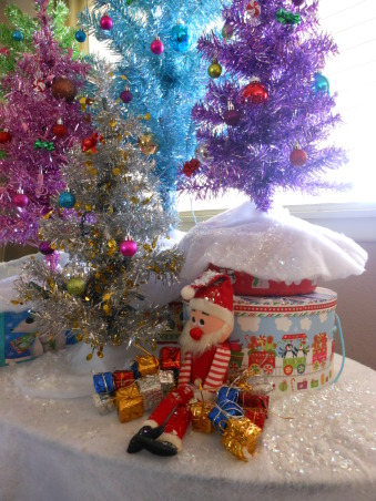 My Tinsel Tree forest, I didn't want the usual christmas tree this year, so I remembered a similar display of many colorful tinsel trees I had seen on a show a few years ago. I collected my trees from several places and put them all together in one display., Holidays Design