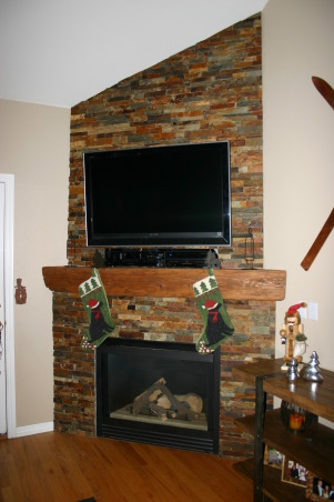 Fireplace Update, We needed a new space to fit in with the room and accommodate the flat TV.  We took old tile down, framed out the old Media hole, and found a nice reclaimed piece of wood to compliment the stacked stone tile., The new fireplace finishes off the room , Other Spaces Design