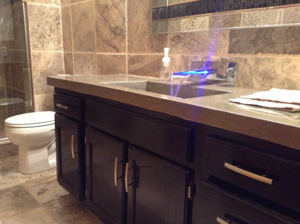 My home bar bathroom, Bathroom remodel job competed by myself with no help. Travertine tile, my home made concrete countertop with integrated sink, shower with light up rain shower head, , Repainted my old vantitey with automotive gloss blak and added new hardware.     , Bathrooms Design
