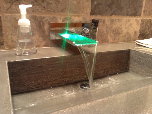 My home bar bathroom, Bathroom remodel job competed by myself with no help. Travertine tile, my home made concrete countertop with integrated sink, shower with light up rain shower head, , Light up wall faucet into my home made concrete countertop sink       , Bathrooms Design