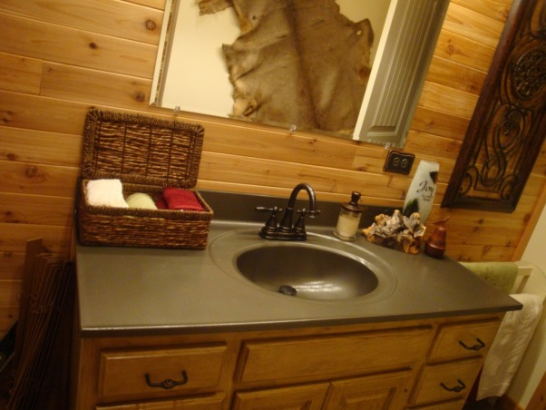 My Cabin feel Bath!, I've always wanted a cabin and realize I wont' be getting one . . . so, I'm going for a cabin feel in my farm house! Initially, Not having much money to redo things, I was just going to paint the ugly baby blue walls and redo the vanity with the rustoleum kit. It's not 100% complete, but . . . Wow! I'm so glad I kept going!!! Bad thing? No before picture :o( Just think: baby blue walls, old & dirty oak with brass/white pulls, cream vanity top, white tulip opaque lights, opaque glass bath doors, white floor with flowers, etc. , Alternate hand towel holder . . . hammered spray paint vanity top. I plan to frame the mirror, again using the decoupaged leaves to cover the frame. . . Or, maybe I'll just put leaves on the corners???      , Bathrooms Design