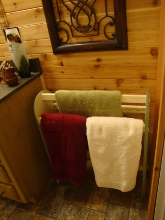 My Cabin feel Bath!, I've always wanted a cabin and realize I wont' be getting one . . . so, I'm going for a cabin feel in my farm house! Initially, Not having much money to redo things, I was just going to paint the ugly baby blue walls and redo the vanity with the rustoleum kit. It's not 100% complete, but . . . Wow! I'm so glad I kept going!!! Bad thing? No before picture :o( Just think: baby blue walls, old & dirty oak with brass/white pulls, cream vanity top, white tulip opaque lights, opaque glass bath doors, white floor with flowers, etc. , Quilt rack repurposed for towel rack. I plan to cover it with leaves that I've decoupaged! Very cool . . . the leaves feel like leather!      , Bathrooms Design