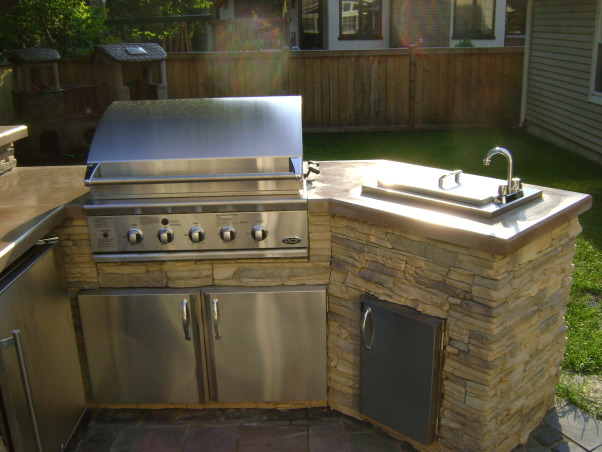 Outdoor Kitchen, Outdoor kitchen with bar and dining space., View of outdoor grill, sink and storage areas. The grill is natural gas and has a rotisserie capable of holding 50 lbs. Great for Thanksgiving dinner., Patios & Decks Design